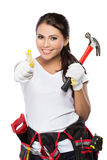Woman holding tool showing thumb up Stock Photo