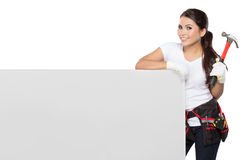 Woman holding tool standing on white board Stock Images