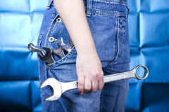 Woman holding tools Stock Photography