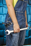 Woman holding tools Stock Image