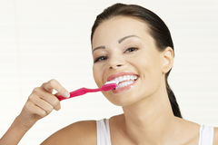 Woman holding tooth brush, isolated Royalty Free Stock Photos