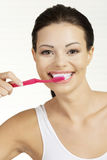 Woman holding tooth brush, isolated Stock Photo