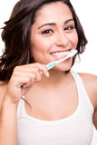 Woman holding a tooth brush Royalty Free Stock Images