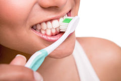 Woman holding a tooth brush. Smiling young woman with healthy teeth holding a tooth brush Stock Photos