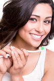 Woman holding a tooth brush. Smiling young woman with healthy teeth holding a tooth brush Royalty Free Stock Images