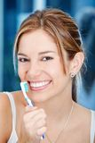 Woman holding a toothbrush Royalty Free Stock Photos