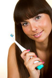 Woman holding a toothbrush Royalty Free Stock Photo