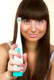 Woman holding a toothbrush Royalty Free Stock Images