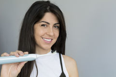 Woman holding toothbrush with black charcoal toothpaste Royalty Free Stock Images
