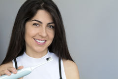 Woman holding toothbrush with black charcoal toothpaste Stock Image