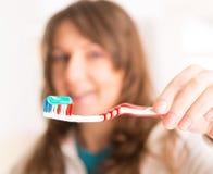 Woman holding toothbrush Stock Image