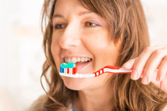 Woman holding toothbrush Royalty Free Stock Images