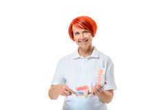 Woman holding toothbrush over white background Royalty Free Stock Photo