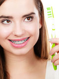 Woman holding toothbrush, thinking about hygiene Stock Photos