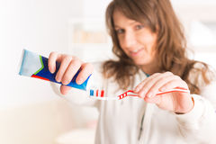 Woman holding toothbrush and toothpaste Royalty Free Stock Photos
