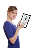 Woman holding a touchpad pc, reading a newspaper Royalty Free Stock Photo