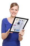 Woman holding a touchpad pc, reading a newspaper Stock Photography