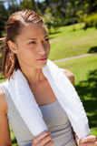 Woman holding a towel with both hands Royalty Free Stock Photos