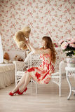 Woman holding a toy bear in a nursery Royalty Free Stock Photo