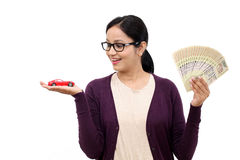 Woman holding a toy car and Indian rupee notes Stock Images