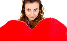 Woman holding a toy heart Stock Images