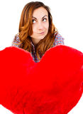 Woman holding a toy heart Royalty Free Stock Image