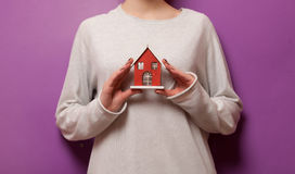 Woman holding a toy house Royalty Free Stock Photo
