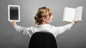 Woman holding traditional book and e-book reader Royalty Free Stock Photography