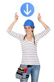 Woman holding a traffic sign Royalty Free Stock Images