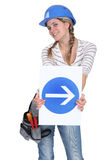 Woman holding traffic sign Royalty Free Stock Photo