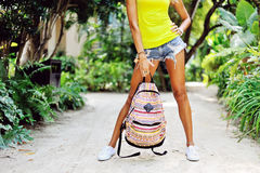 Woman holding travel bag. Sexy female legs outdoor portrait. Clo Stock Photo