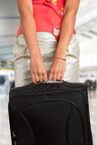 Woman Holding a Travel Bag Stock Photo