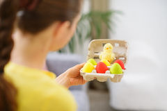 Woman holding tray with colorful Easter eggs Stock Photography