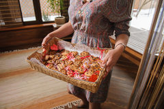 Woman holding a tray with cookies in form of heart Royalty Free Stock Image