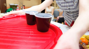 Woman holding a tray with disposable coffee cups Royalty Free Stock Image