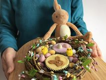 Woman holding a tray full of Easter treats royalty free stock photos