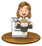 A woman holding a tray with a hot drink Stock Photography