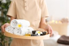 Woman holding tray with treatments. In spa salon Stock Photos