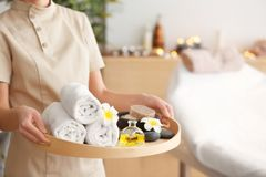 Woman holding tray with treatments. In spa salon Stock Photo