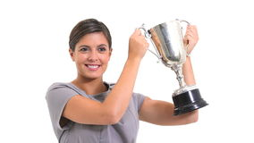 Woman holding a trophy. Against white background stock video footage