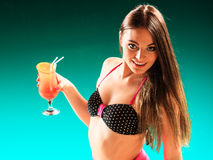 Woman holding tropical drink on pool. Stock Photo