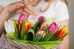 Woman holding tulips Stock Photography