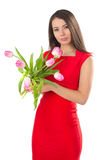 A woman is holding tulips Stock Photo