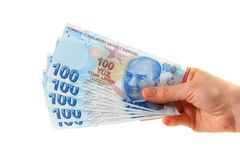 Woman holding turkish lira Stock Images