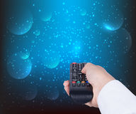 Woman holding TV remote control Royalty Free Stock Photo