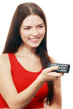 Woman holding TV remote control Stock Image