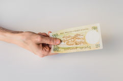 Woman holding twenty Bhutanese Ngultrum banknote in her hand Stock Photo