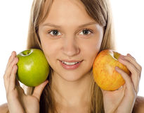 Woman holding two apples - green and red. Stock Photography