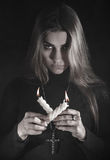 Woman holding two candles in a smoke Royalty Free Stock Photo