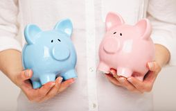 Woman Holding Two Coin Banks Stock Images